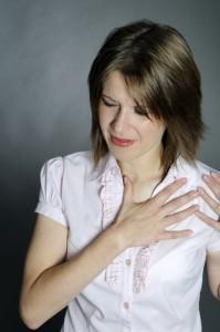 боль в груди перед месячными